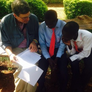 Brett going over grades with Victor Otieno and Nicholus Okoth